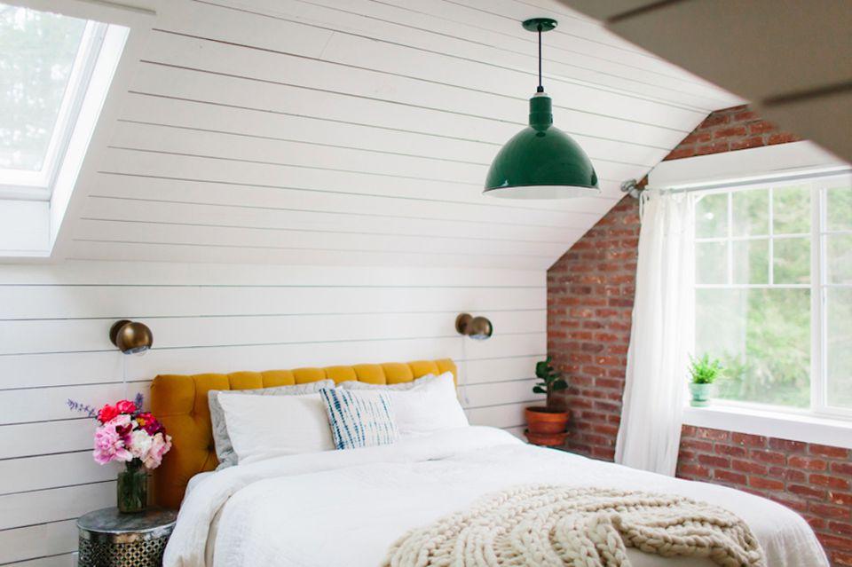 attic bedroom with brick wall