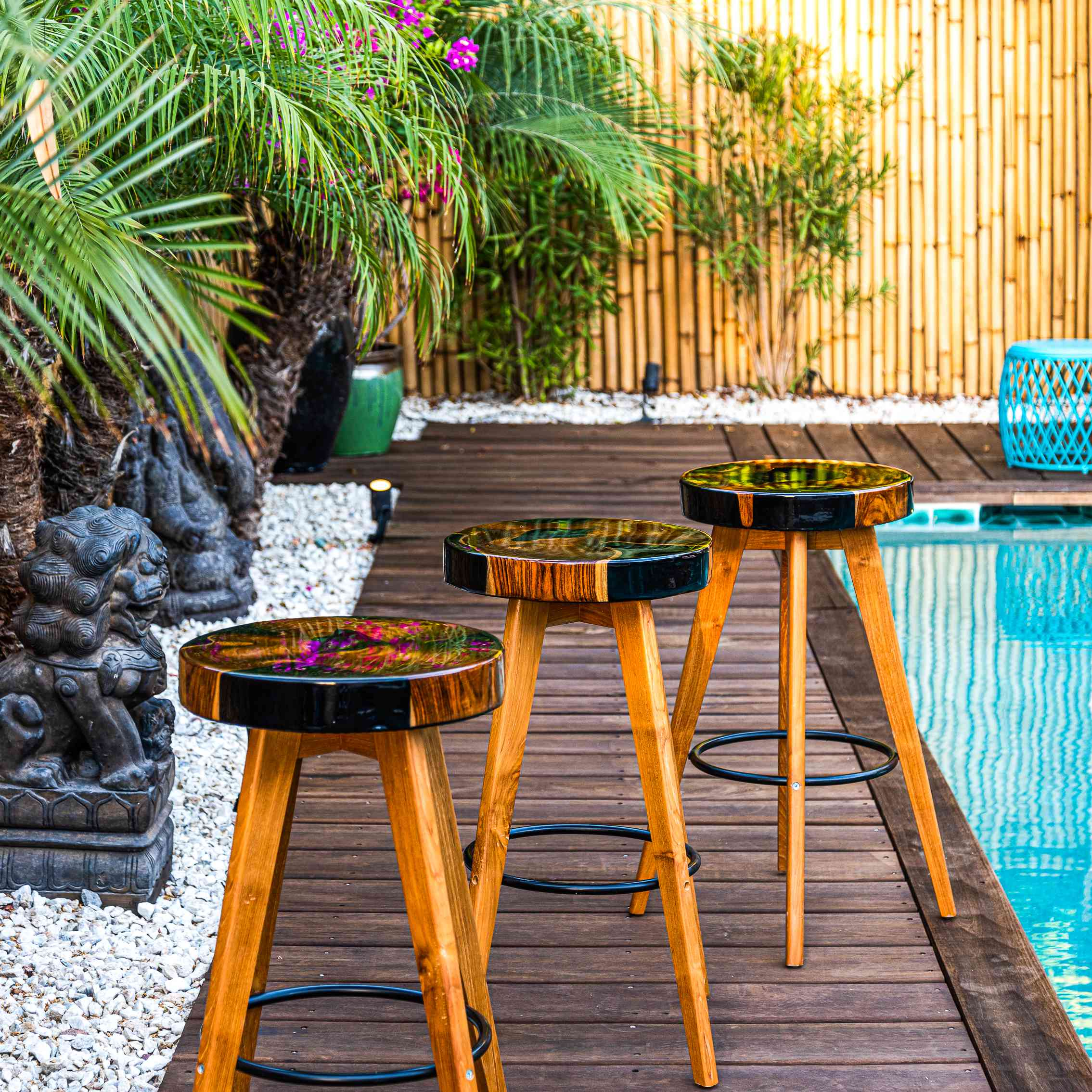 3 hand-designed stools at a pool side