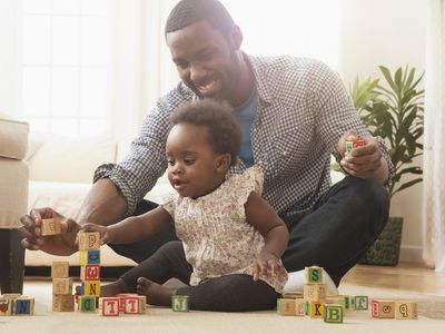 one year old playing with blocks
