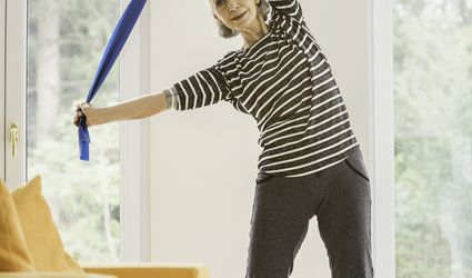 Lady Stretching with Resistance Band