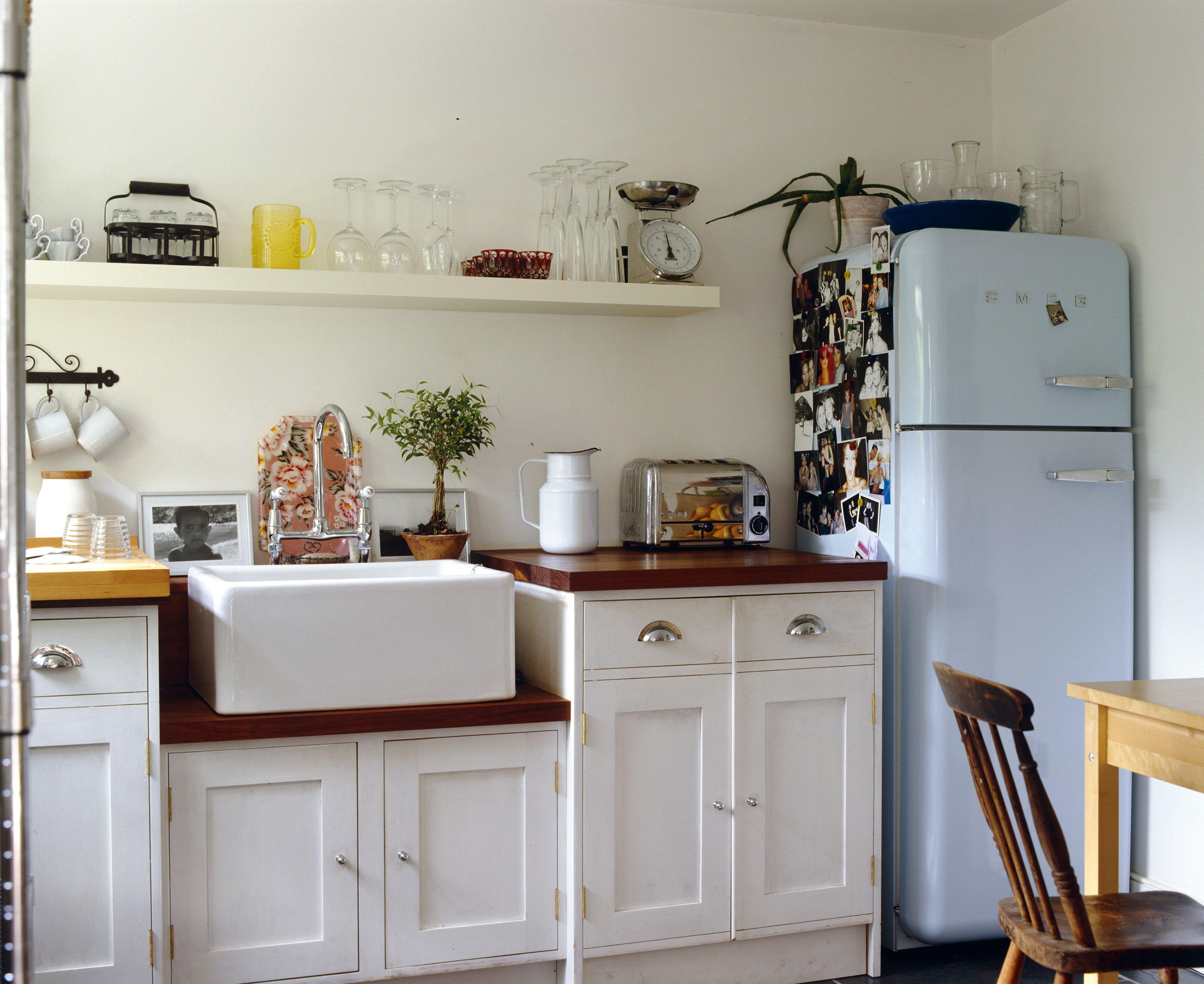 Kitchen with light blue refrigerator.