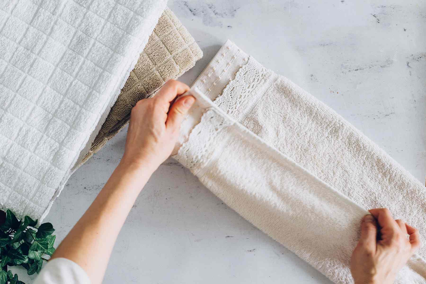 person folding a towel