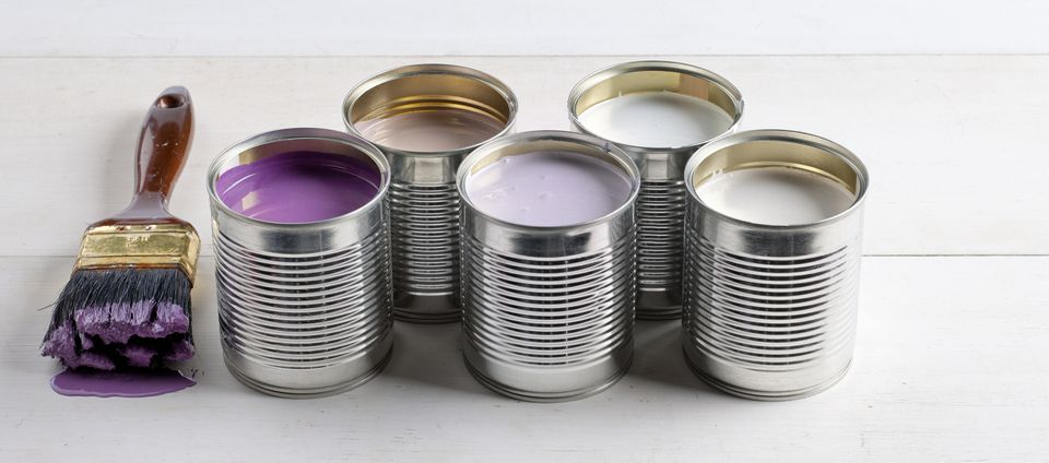 Cans of pink, purple, and lavender paint