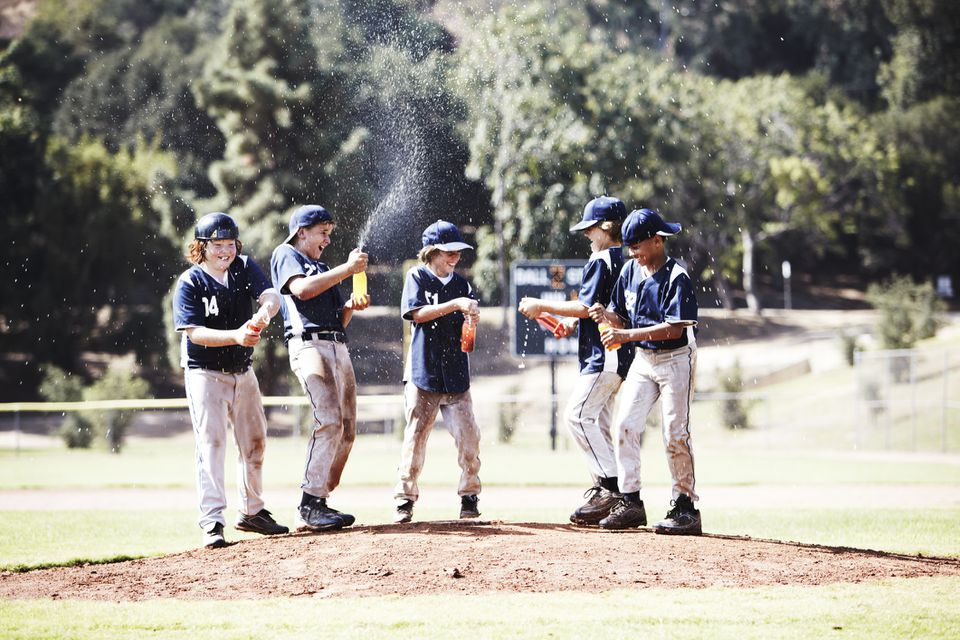 Kids wearing baseball uniforms