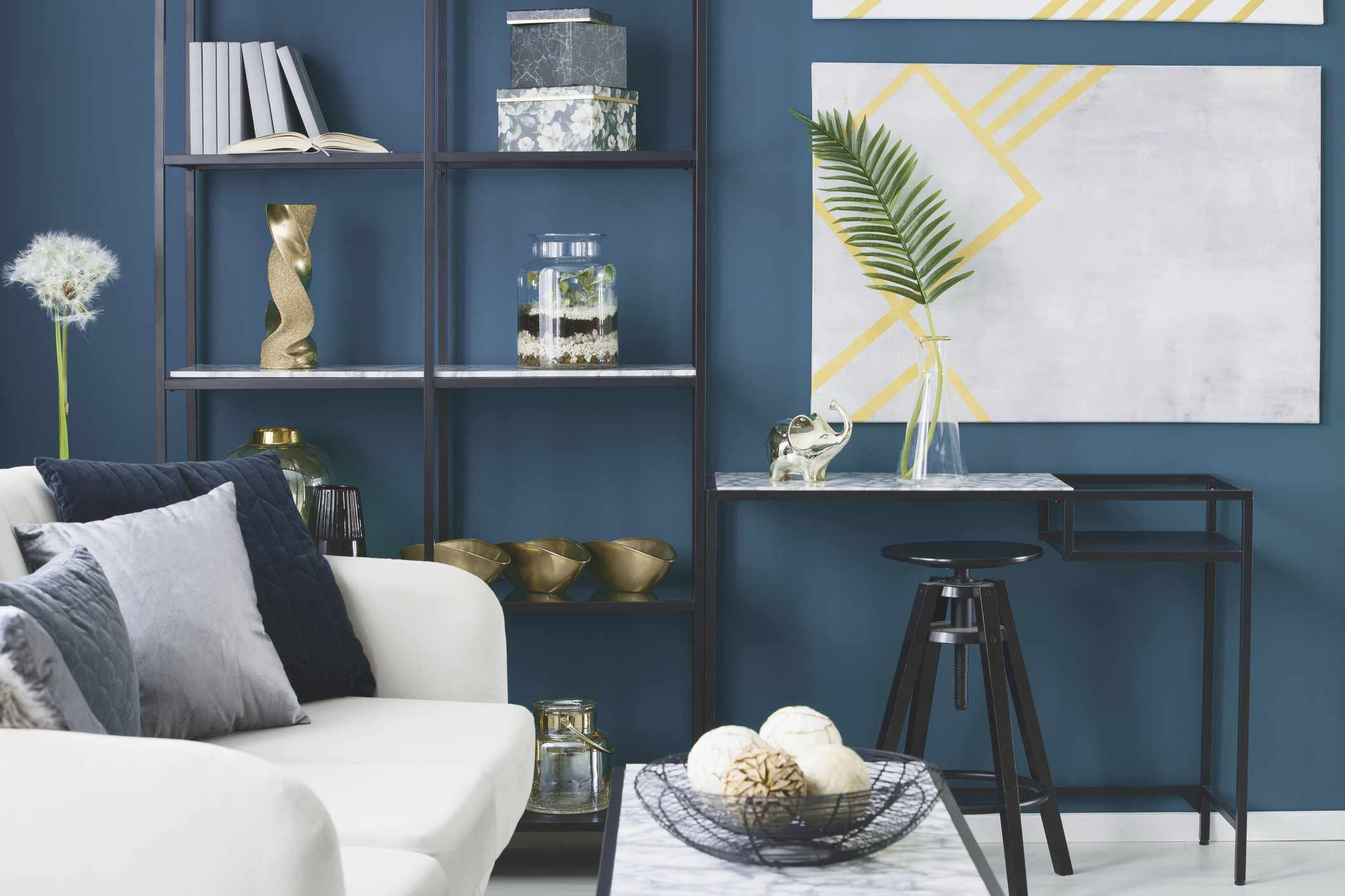 Elephant and leaf in vase interior with blue wall