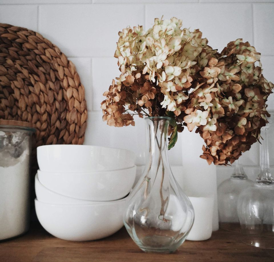 Shelf with clean bowls and vase of flowers