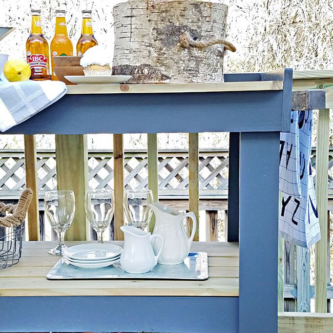 A blue serving table on a deck