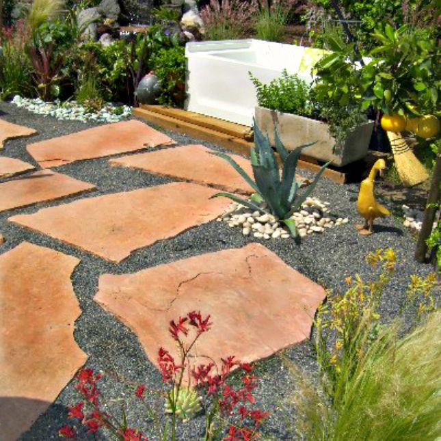 flagstone and gravel patio in a backyard