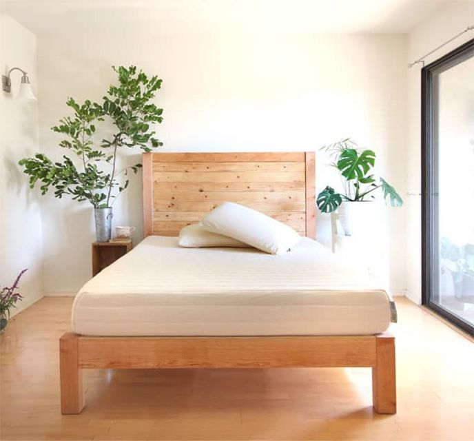 A bed frame in a bedroom