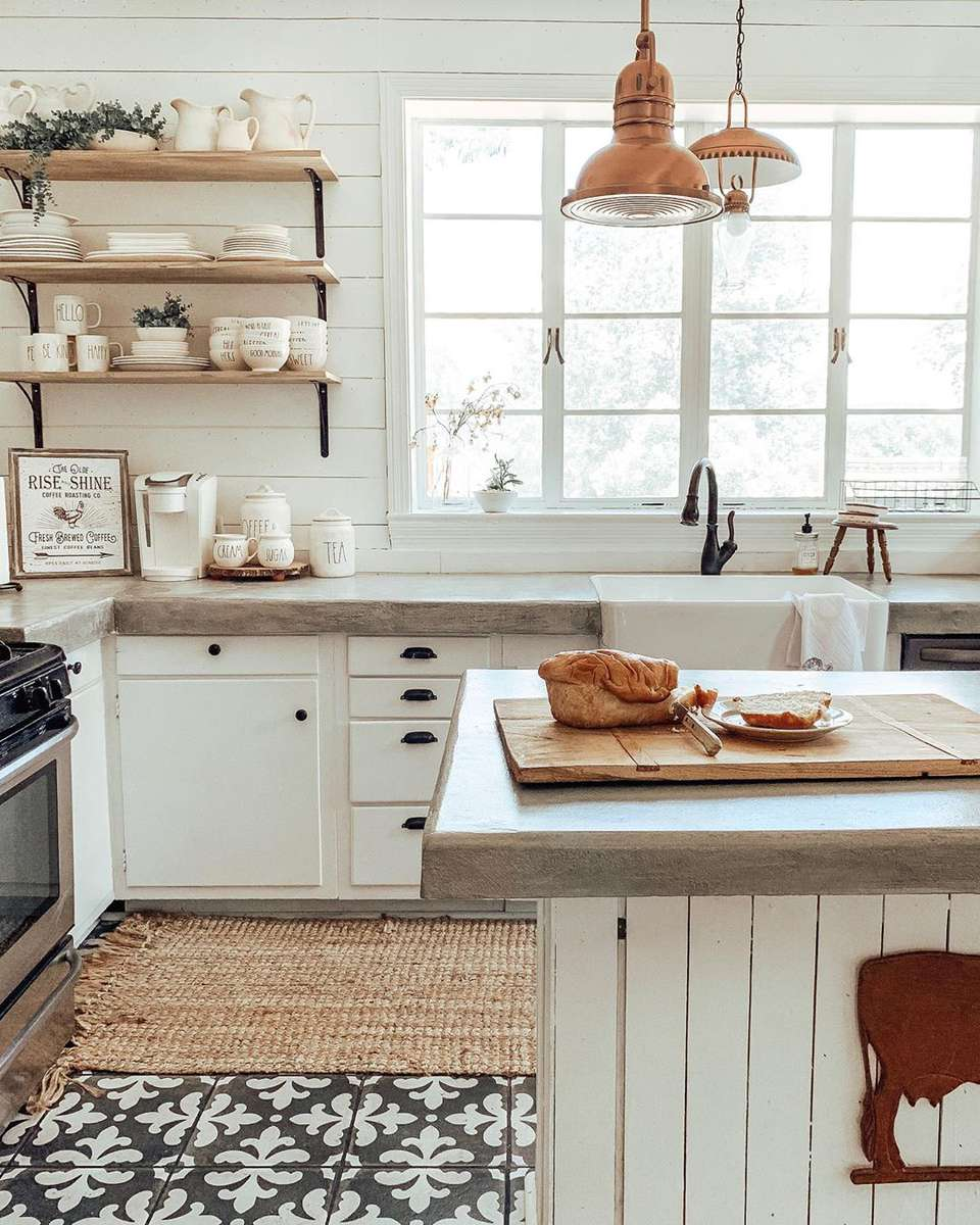 Kitchen with patterned tiles and white kitchen island