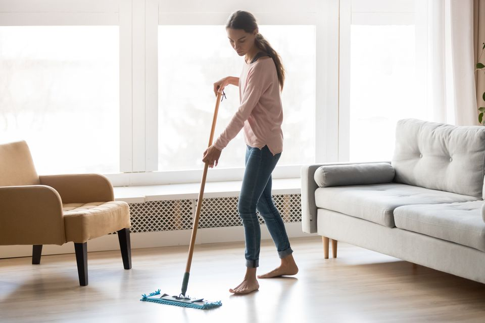 Woman cleaning laminate floor
