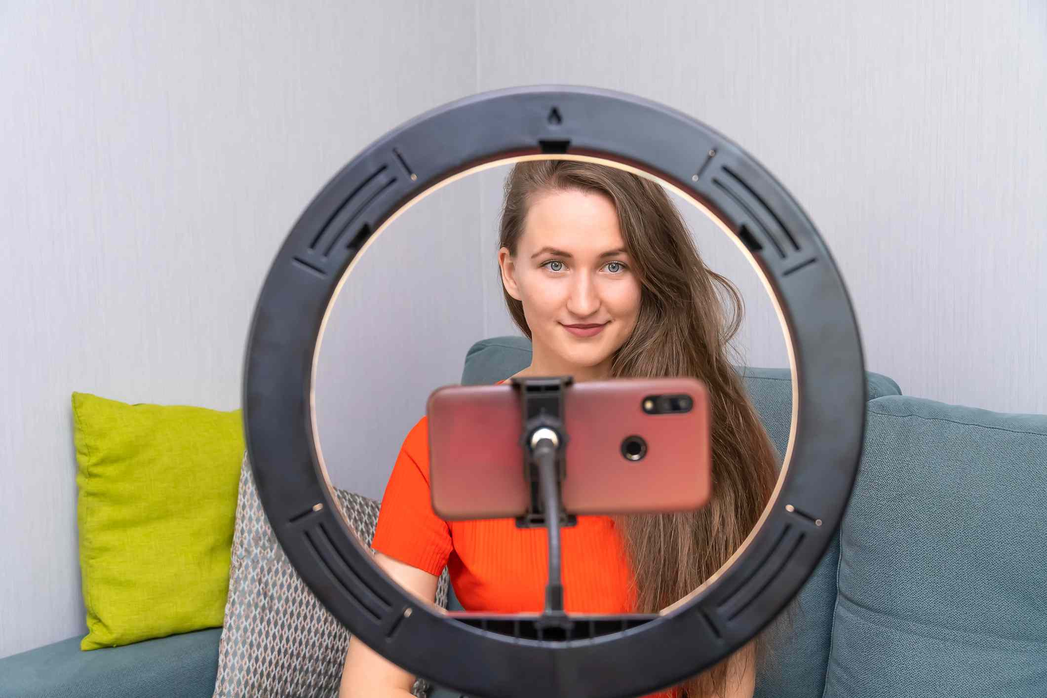A woman in front of a selfie light