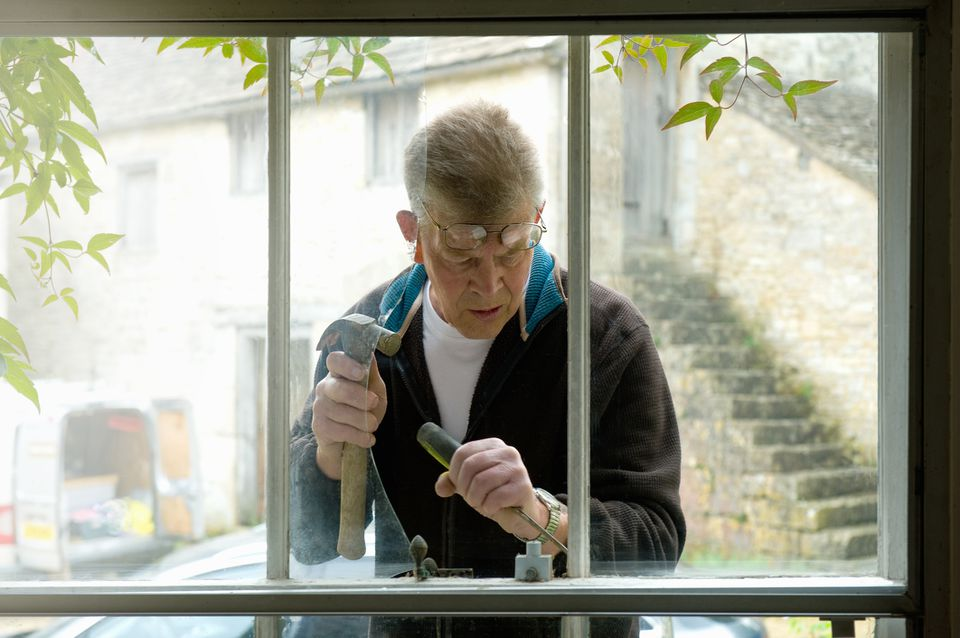 A man fixing a broken window