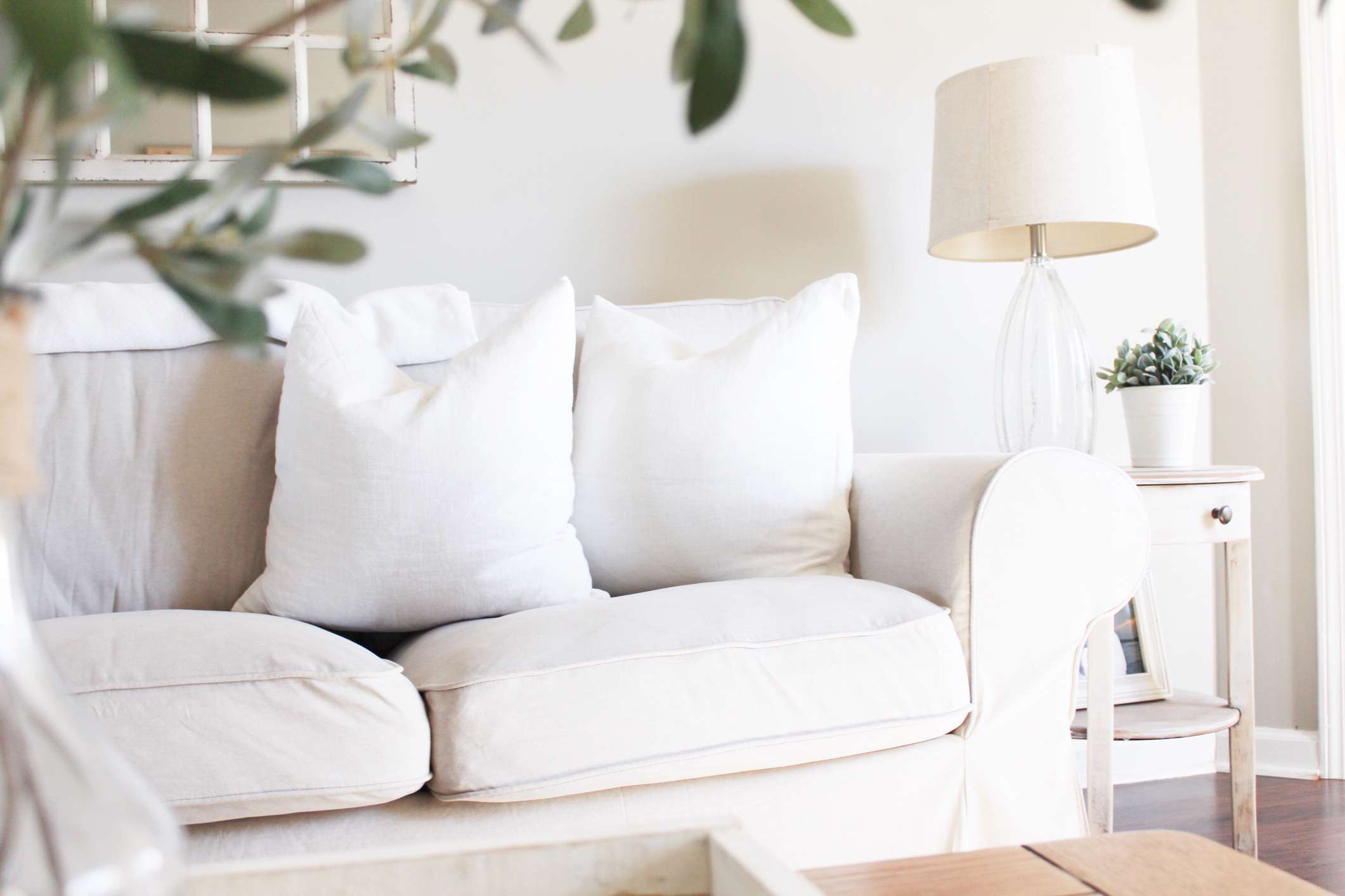 A white couch in a white living room
