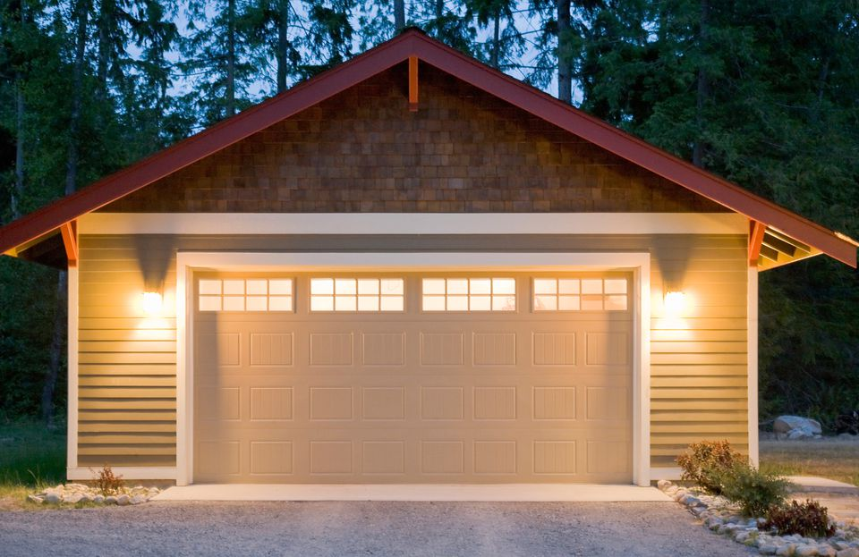 Exterior of residential garage with security lights