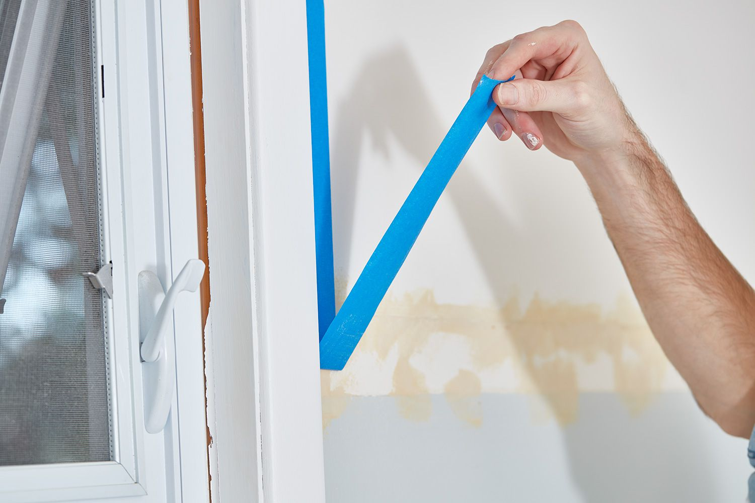 Remove painter's tape from window trim