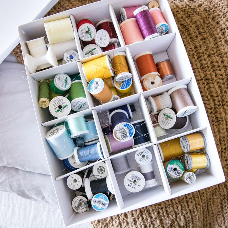 thread organized in a box with inserts