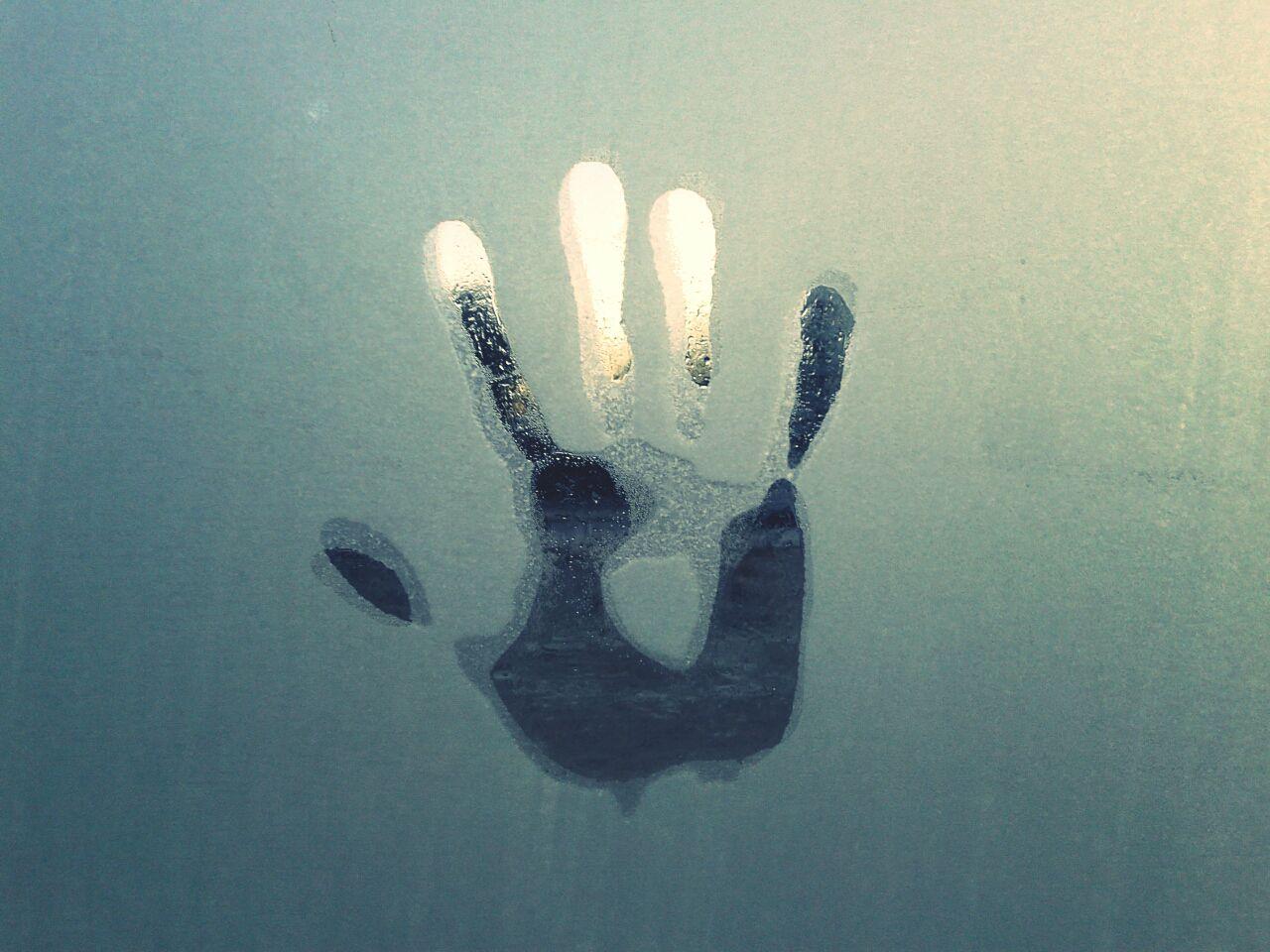 handprint on foggy window