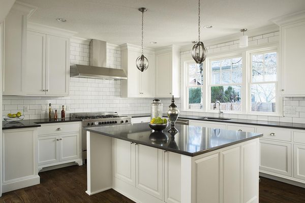 New Custom kitchen with white cabinets and solid surface island.