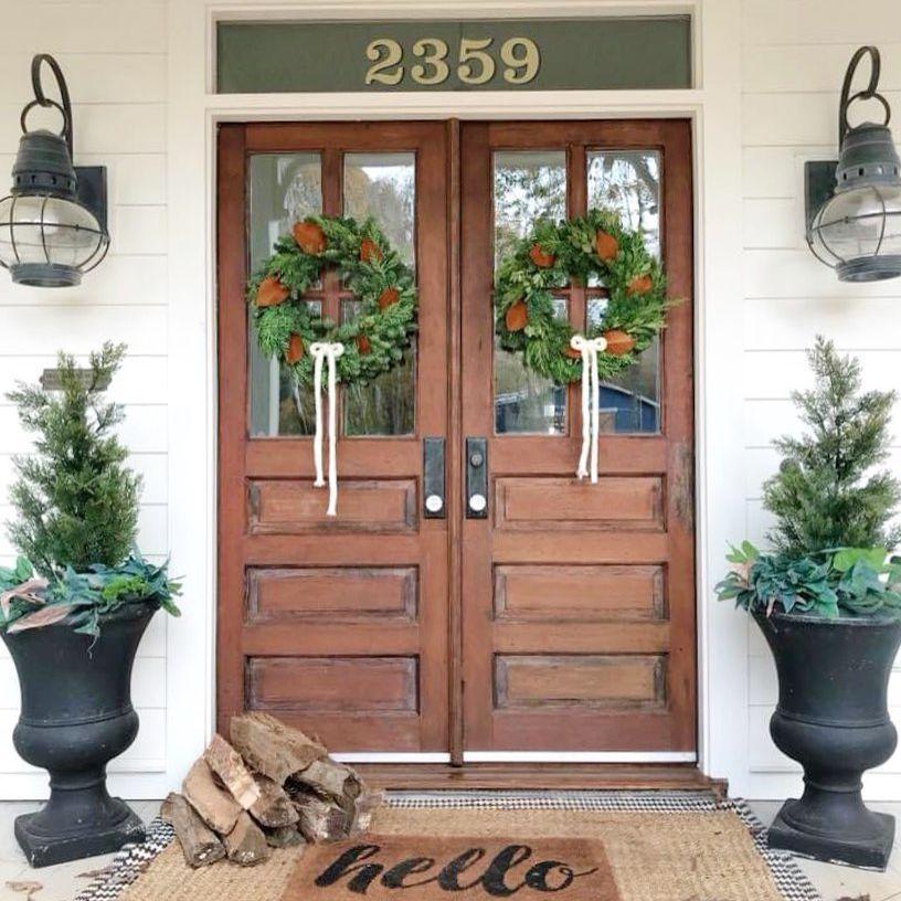 Brown double doors with wreaths