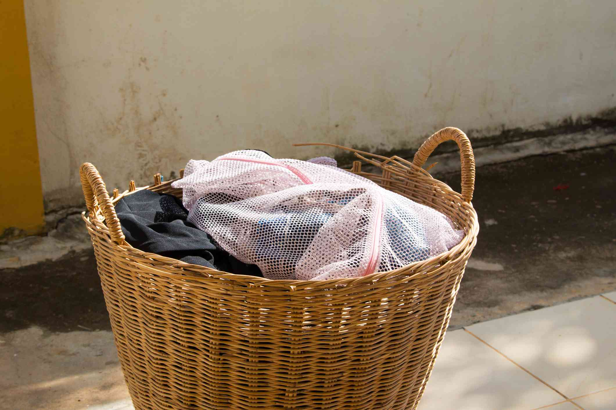 Clothes In Wicker Basket Outdoors