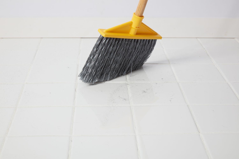 Sweeping tile floor