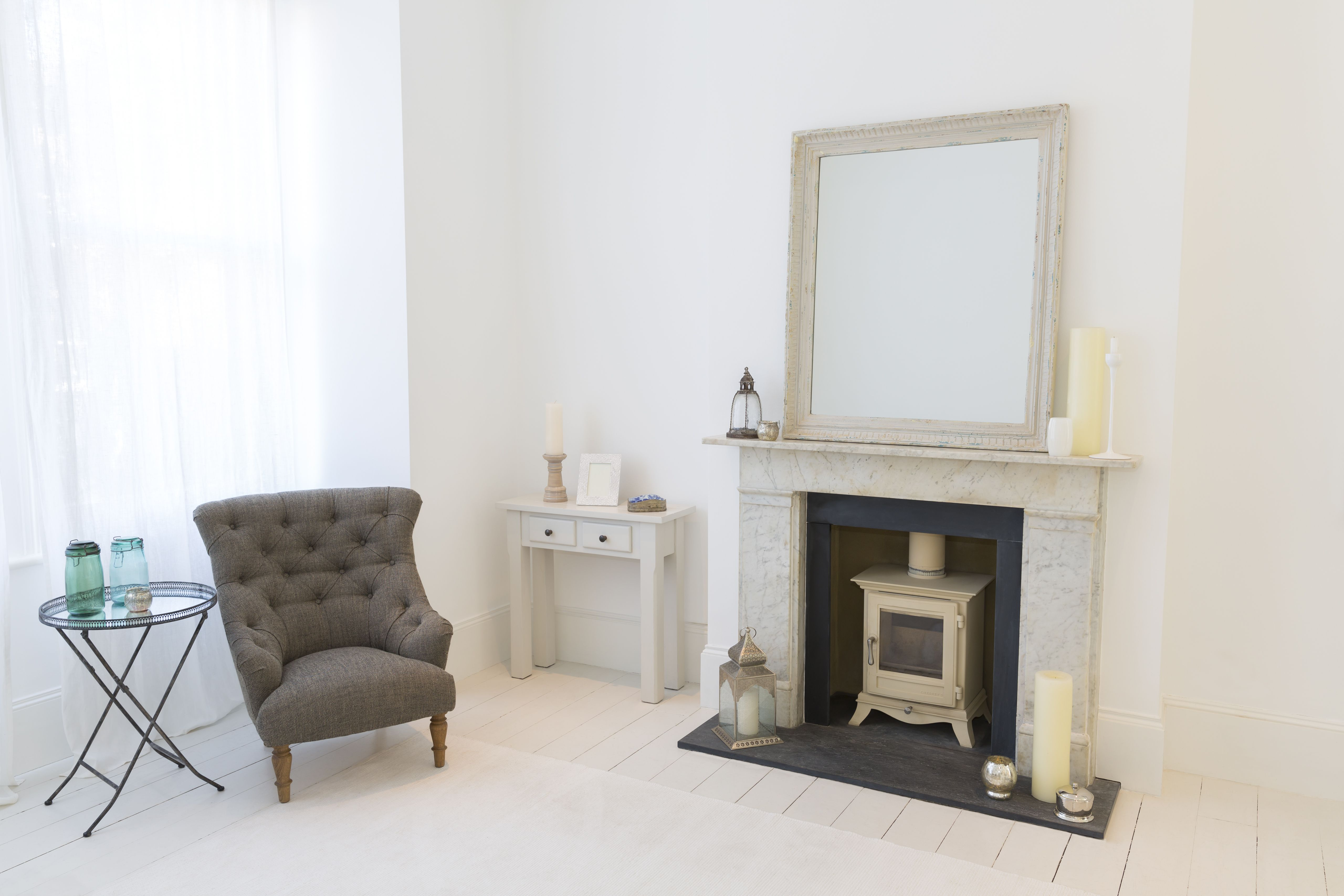 Armchair and fireplace in living room