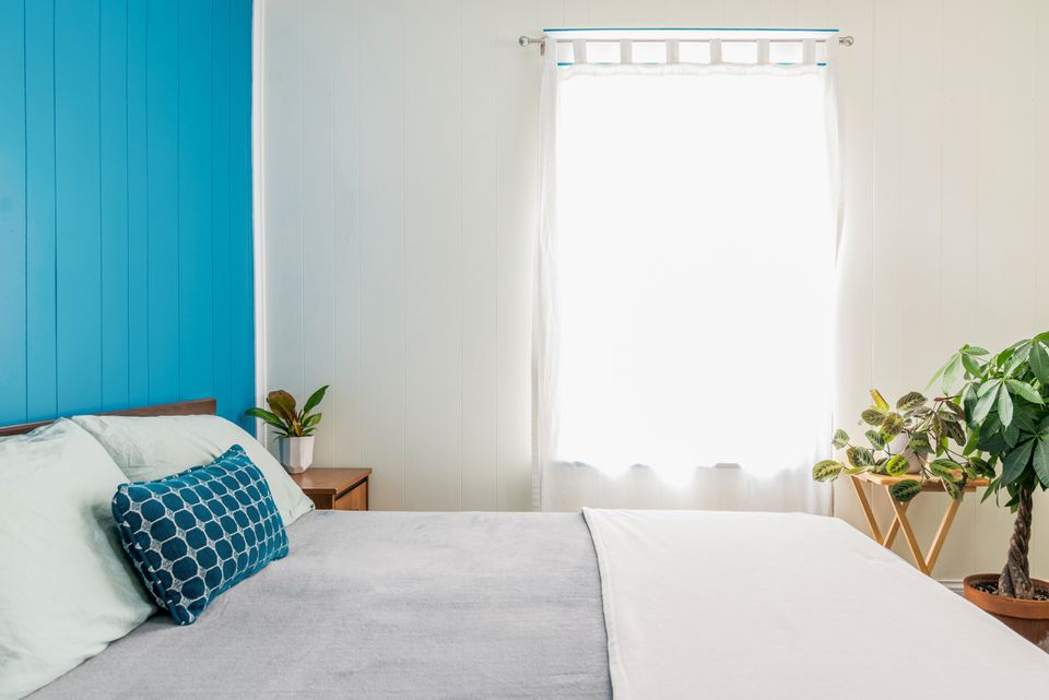 blue accent wall in a bedroom