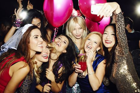 Group Of Friends Taking Self Portrait With Phone Brand New Images Getty Bachelorette Scavenger Hunts