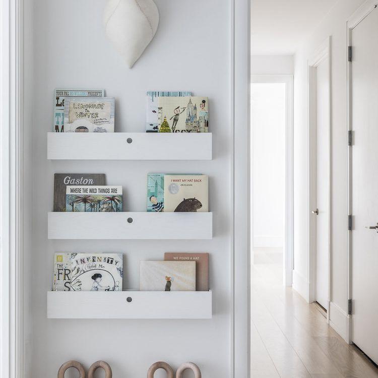 White bookshelves in a playroom