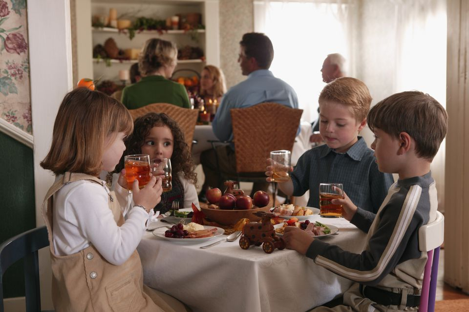 Children toasting with juice