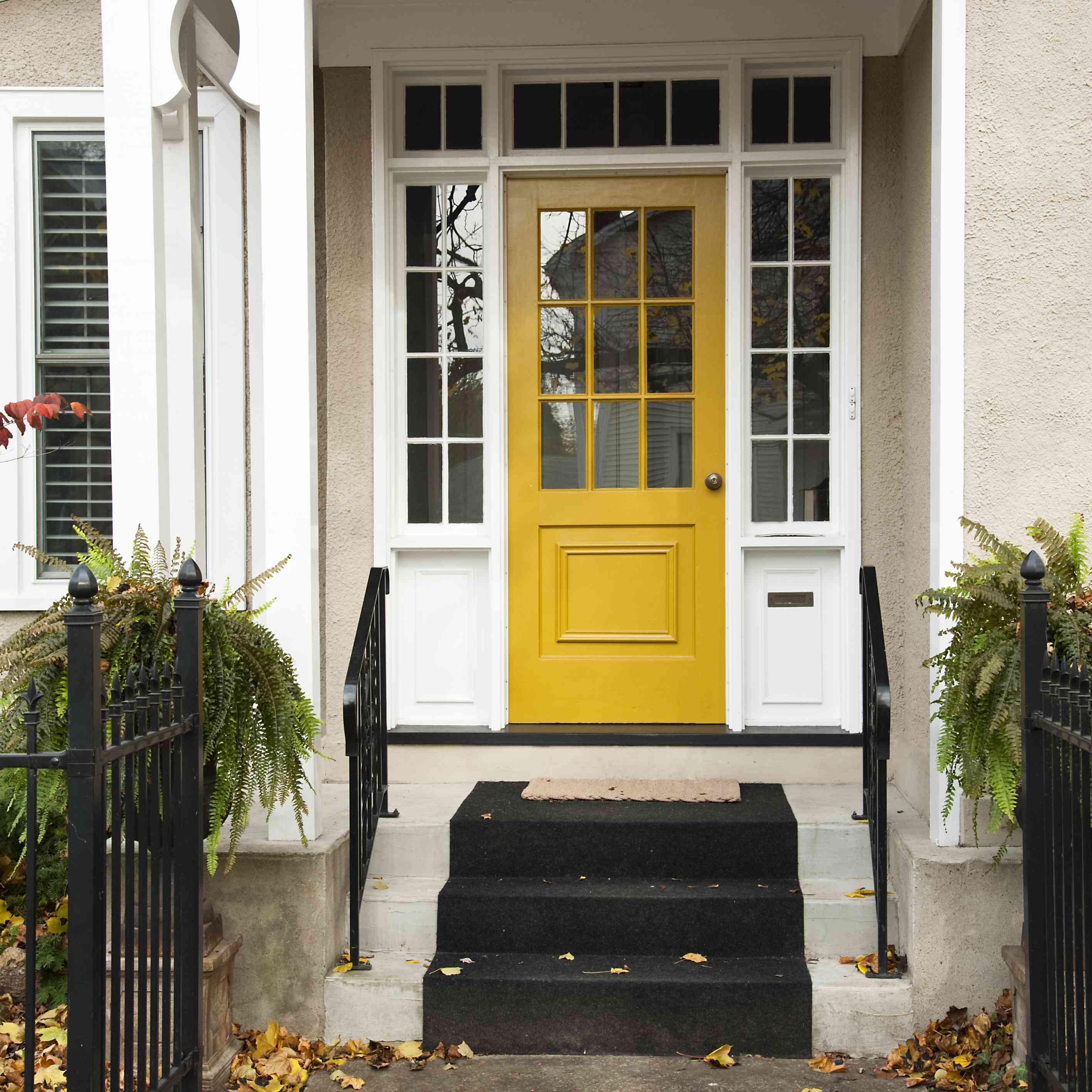 Yellow door on white house