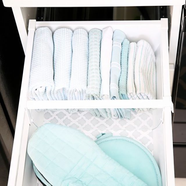 Kitchen towels folded in a drawer