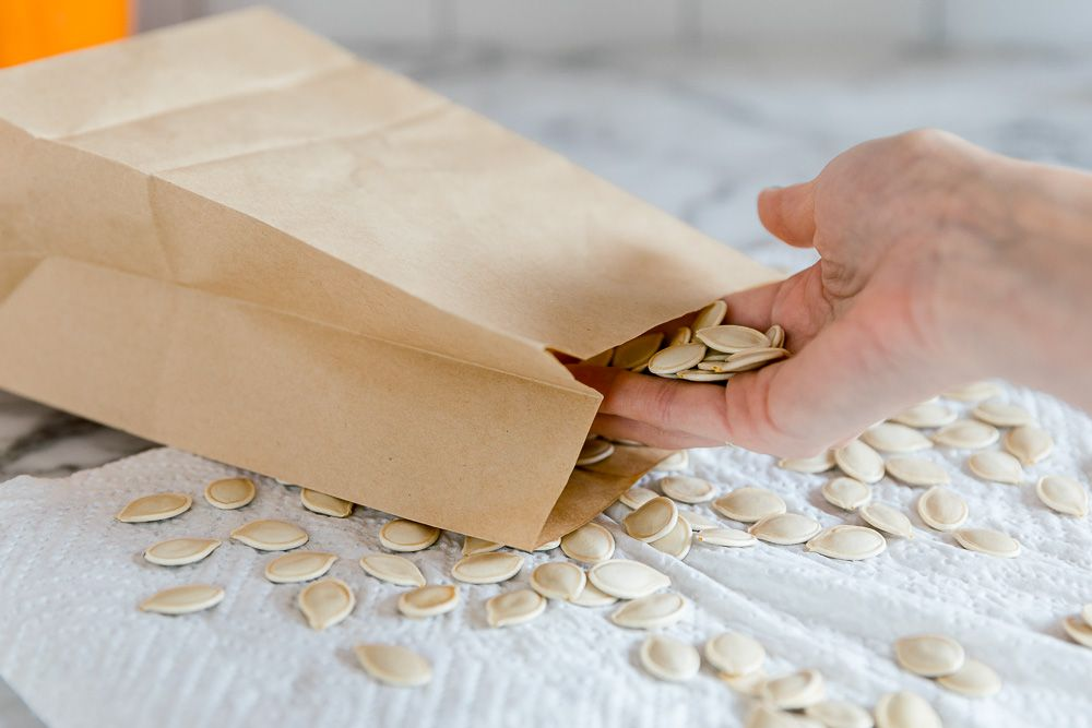 placing the seeds in a brown paper bag