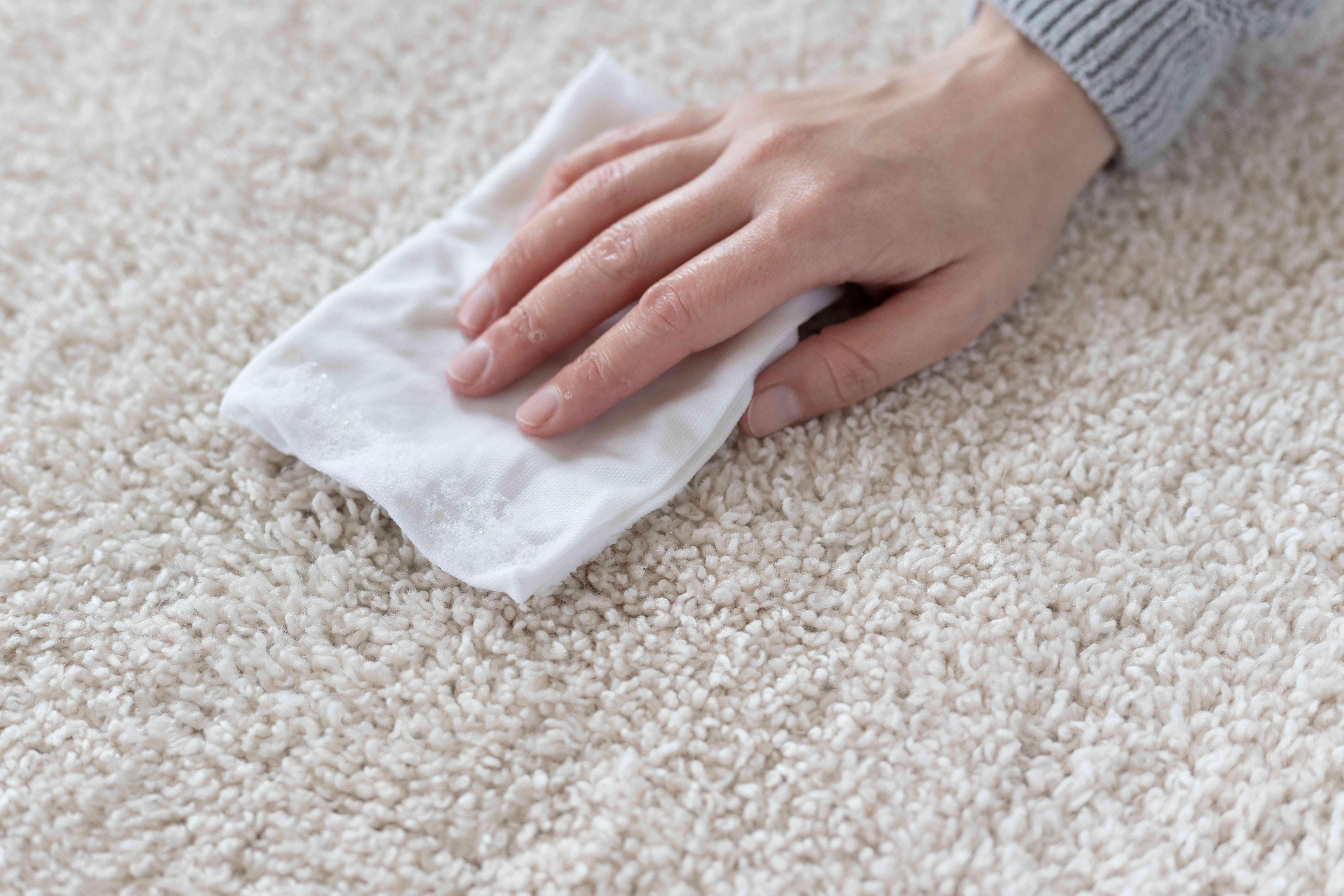 White paper towel blotting carpet with easter egg stain