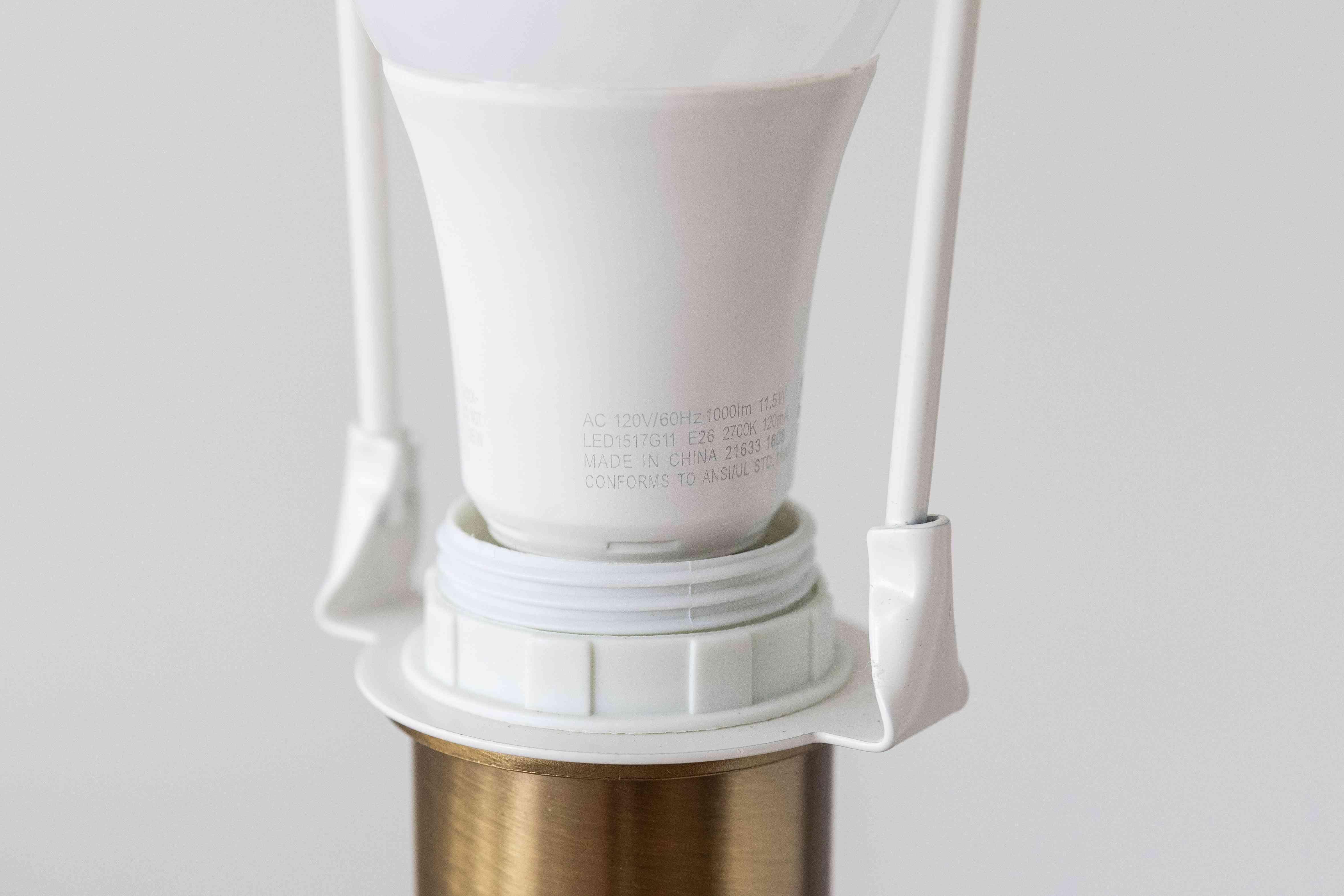 Maximum wattage label on bottom of light bulb in fixture