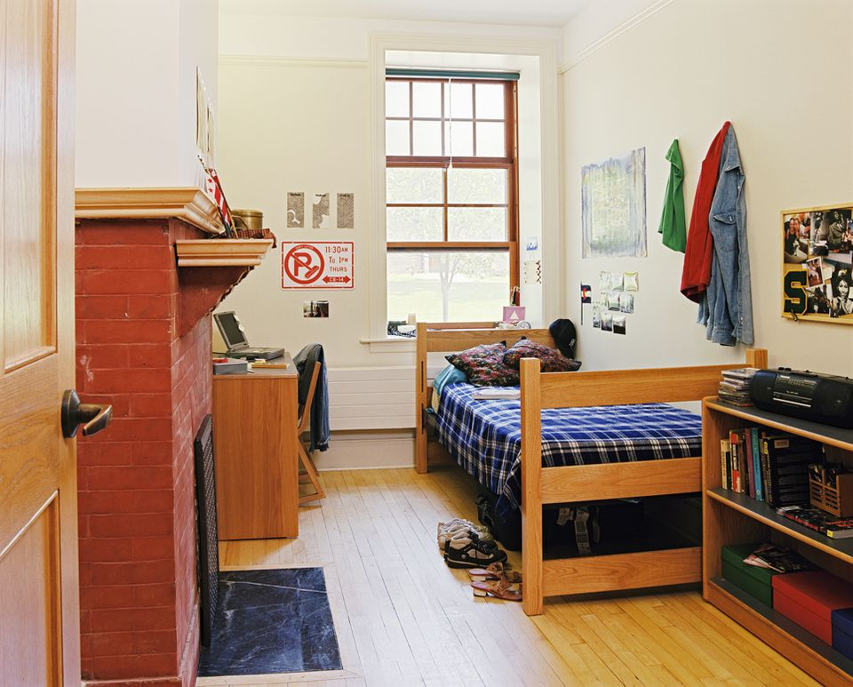 Dorm Room with Brick Fireplace and Wood Floor
