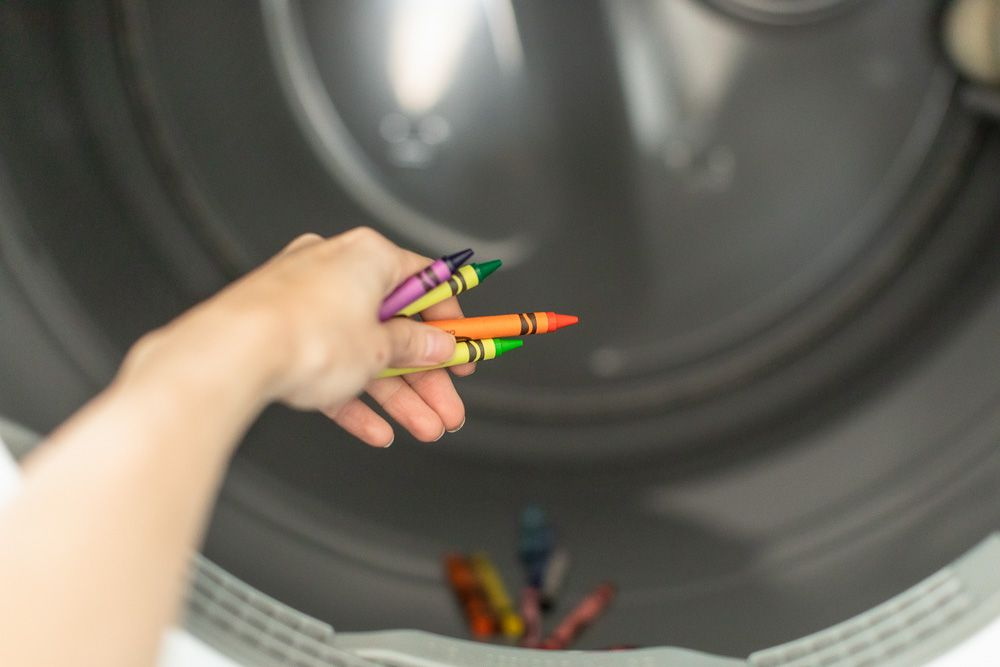 Crayons being taken out of dryer machine