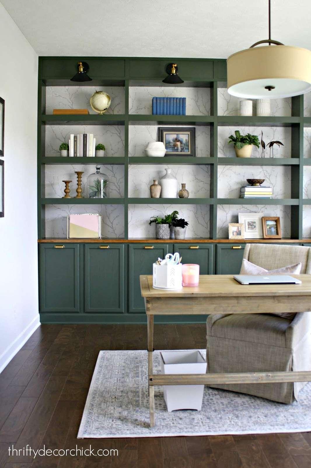 Green bookshelves in an office