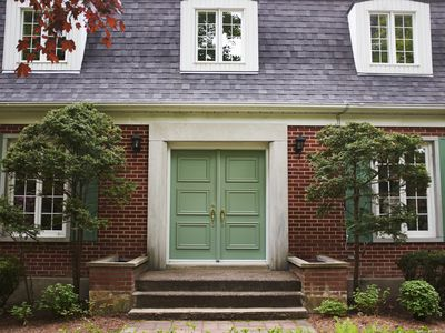 a house exterior with a green front door