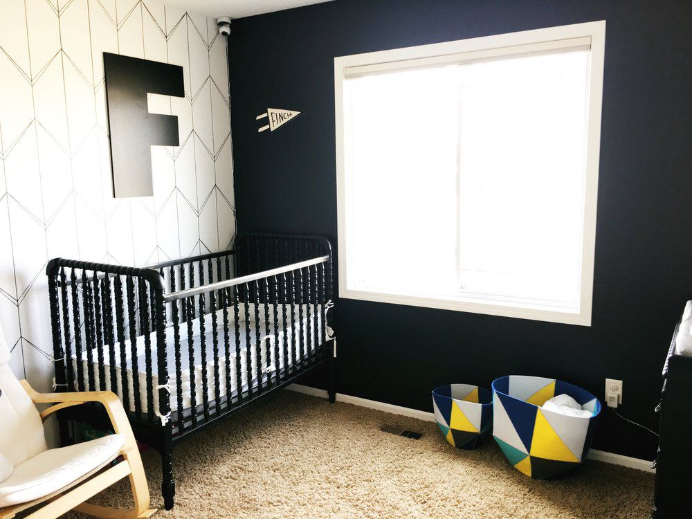 Black and white nursery with geometric accent wall