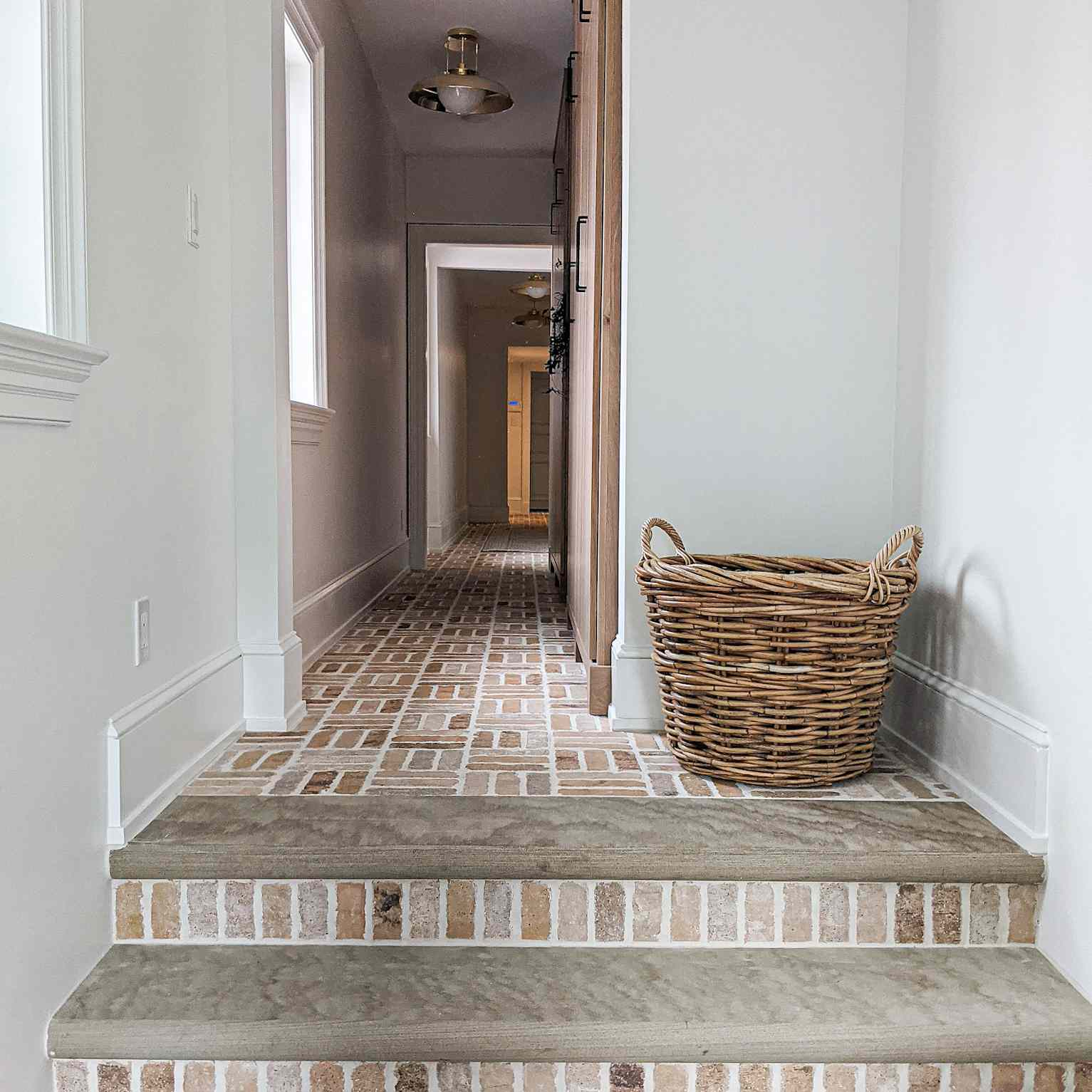 brick stairs with a wicker basket in a hallway