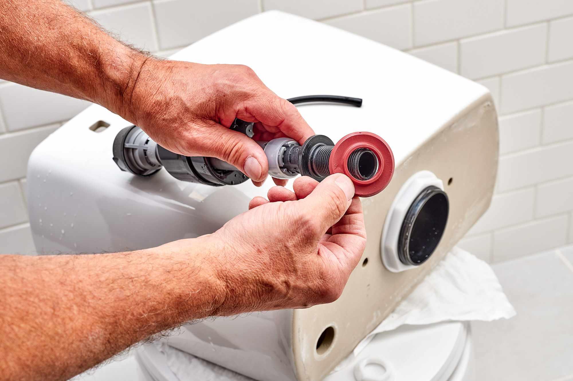 Red beveled washer slid onto tailpiece of flush valve
