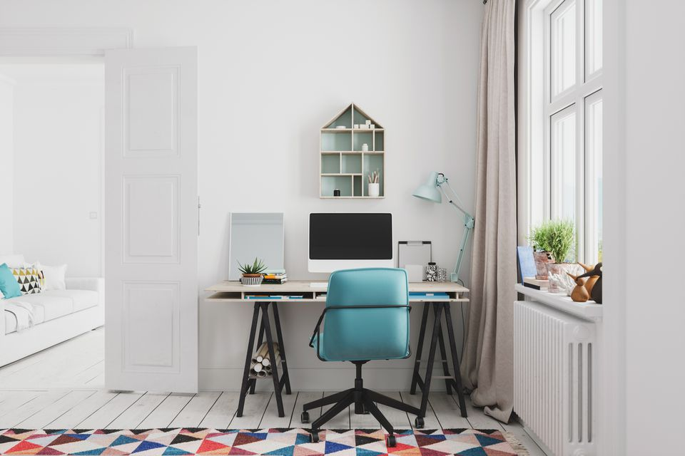 home office interior with colorful rug and blue chair