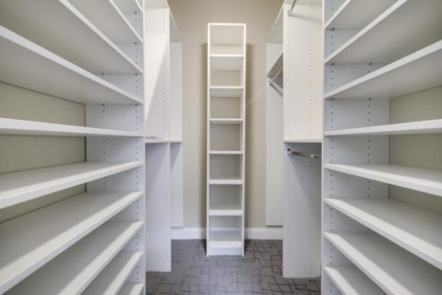 empty closet with lots of shelving