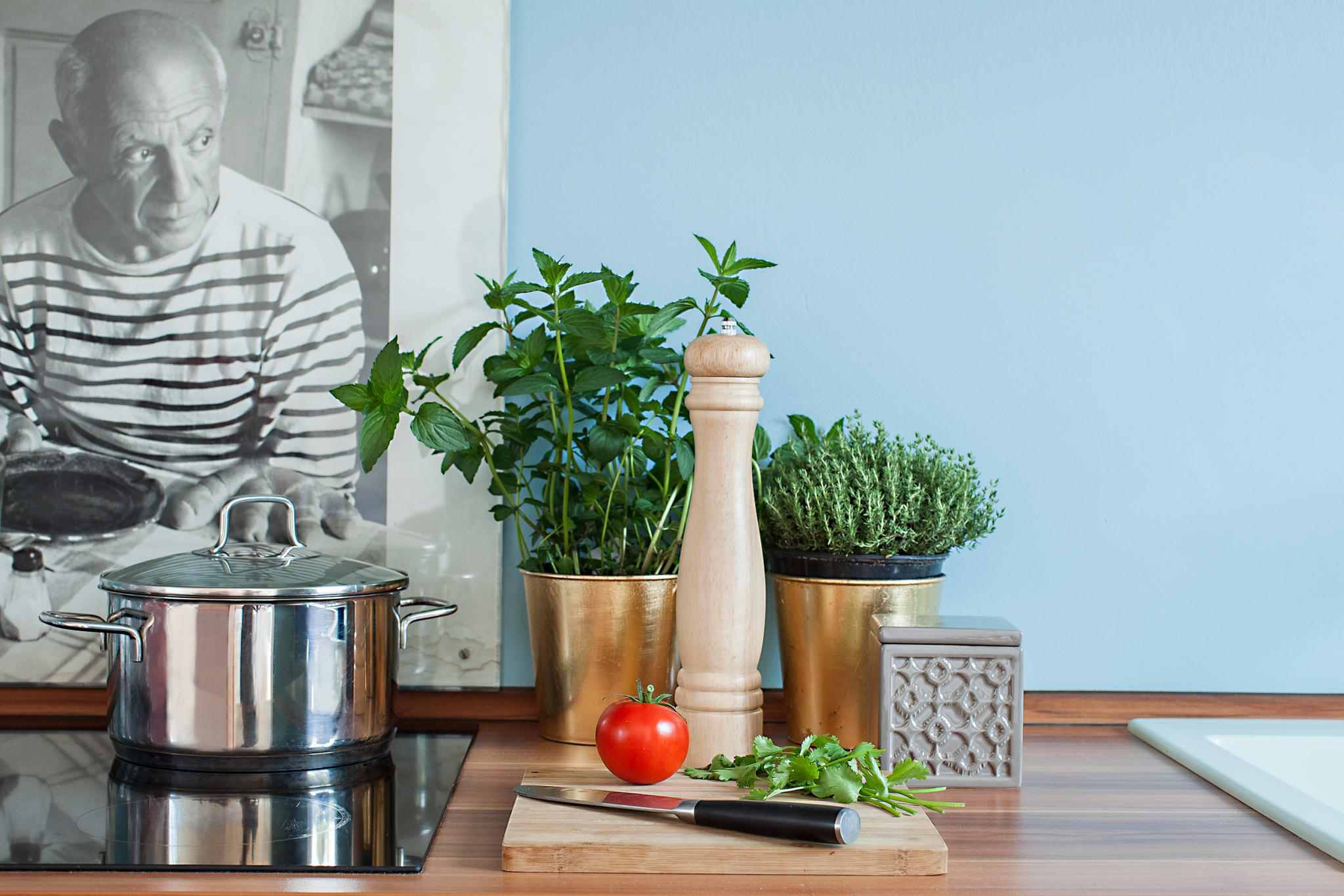 greenery and fresh herbs in kitchen