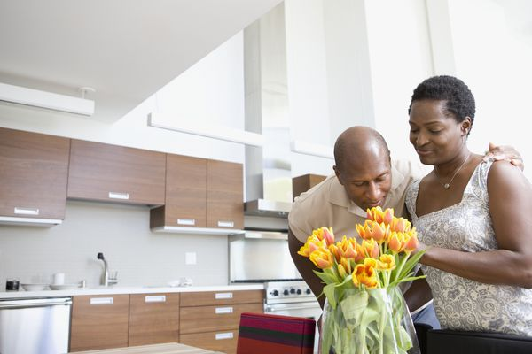 Couple enjoying fresh flowers at home