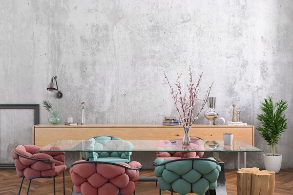 Modern dining room with glass walls, colorful chairs and gray textured wall.