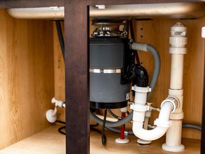 Garbage disposal under kitchen sink