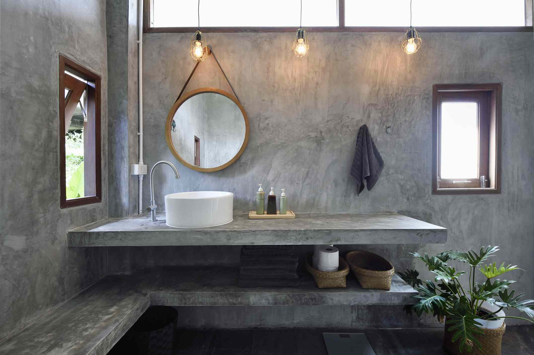 Concrete bathroom with hanging bulb lights